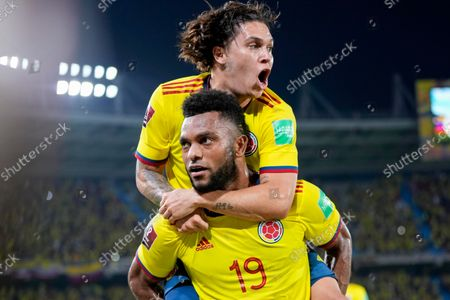 Colombia's Miguel Borja (19) celebrates with teammate Juan Quinteroo after scoring his side's second goal against Chile during a qualifying soccer match for the FIFA World Cup Qatar 2022 in Barranquilla, Colombia