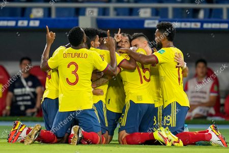 Players of Colombia celebrate after Miguel Borja secured his side's second goal against Chile during a qualifying soccer match for the FIFA World Cup Qatar 2022 in Barranquilla, Colombia