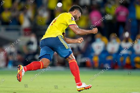 Stock Picture of Colombia's Miguel Borja (19) scoring from the penalty spot his side's first goal against Chile during a qualifying soccer match for the FIFA World Cup Qatar 2022 in Barranquilla, Colombia
