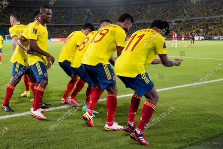 Stock Photo of Colombia's Miguel Borja, second from right, dances with teammates after scoring his side's second goal against Chile during a qualifying soccer match for the FIFA World Cup Qatar 2022 in Barranquilla, Colombia
