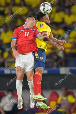 Chile's Gary Medel (17) and Colombia's Miguel Borja go for a header during a qualifying soccer match for the FIFA World Cup Qatar 2022 in Barranquilla, Colombia