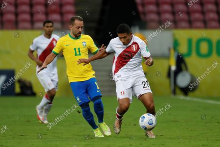 Brazil's Everton Ribeiro (L) in action against Peru's Edison Flores (R) during a South American qualifiers match for the Qatar 2022 World Cup between Brazil and Peru at the Arena Pernambuco in Recife, Brazil, 09 September 2021.