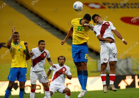 Stock Image of Brazil's Lucas Verissimo (C) in action against Peru's Edison Flores (R) during a South American qualifiers match for the Qatar 2022 World Cup between Brazil and Peru at the Arena Pernambuco in Recife, Brazil, 09 September 2021.