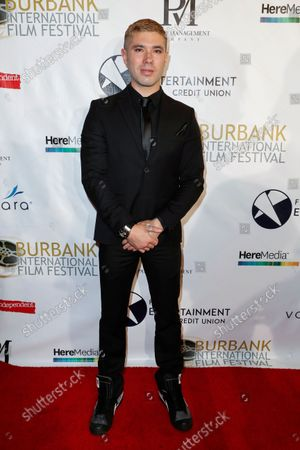 Kristos Andrews poses on the red carpet during the opening night of the 13th Annual Burbank International Film Festival at the Burbank AMC 16 in Burbank, California, USA, 09 September 2021. The opening night films are The Bay and Riders of Justice.