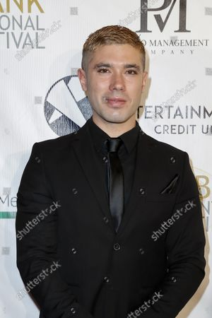 Kristos Andrews poses on the red carpet during the opening night of the 13th Annual Burbank International Film Festival (BIFF) at the Burbank AMC 16 in Burbank, California, USA, 09 September 2021. The opening night films are 'The Bay' and 'Riders of Justice'.