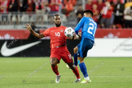 Junior Hoilett, No.10, of Team Canada competes for the ball against Bryan Tamacas, No.21, of Team El Salvador during the CONCACAF World Cup Qualifying 2022 match at BMO Field in Toronto, Canada. Canada won 3-0.