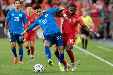 Junior Hoilett, No.10, of Team Canada and Bryan Tamacas, No.21, of Team El Salvador compete for the ball during the CONCACAF World Cup Qualifying 2022 match at BMO field in Toronto, Canada. Canada won 3-0.