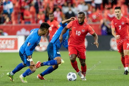 Junior Hoilett, No.10, of Canada competes for the ball against Team El Salvador players (blue) during the CONCACAF World Cup Qualifying 2022 match at BMO Field in Toronto, Canada