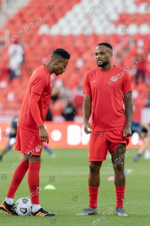 Stock Photo of Mark-Anthony Kaye (L) and Cyle Larin (R) of Team Canada during the warm up of the CONCACAF World Cup Qualifying 2022 match against Team El Salvador at BMO Field in Toronto, Canada