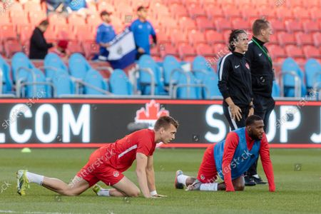 Alistair Johnston (L) and Junior Hoilett (R) of Team Canada during the warm up before the CONCACAF World Cup Qualifying 2022 match against Team El Salvador at BMO Field in Toronto, Canada