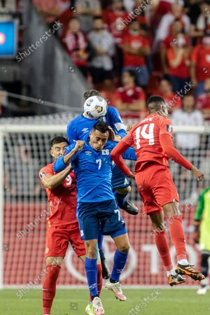 Darwin Cerén, No.7, of Team El Savaldor competes for the ball against two players of Team Canada, Mark-Anthony Kaye (No.14) and Lucas Cavallini (No.9) during the CONCACAF World Cup Qualifying 2022 match at BMO Field in Toronto, Canada. Canada won 3-0.