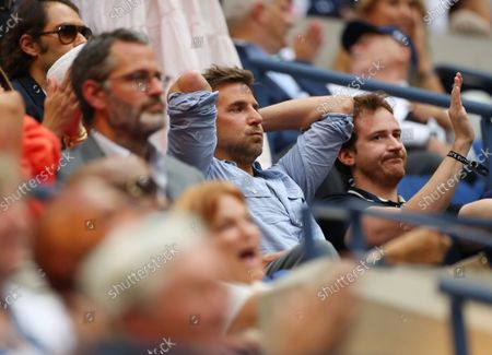 Bradley Cooper watching the action