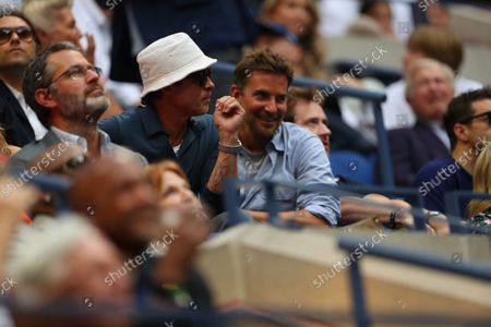 Brad Pitt and Bradley Cooper watching the action