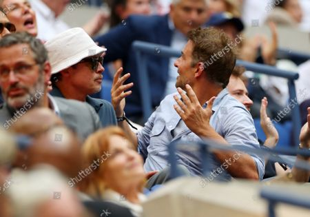 Stock Image of Brad Pitt and Bradley Cooper watching the action