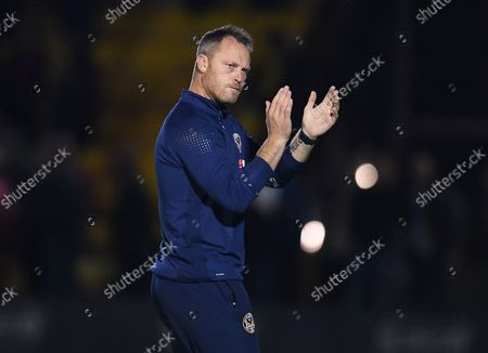 Stock Photo of Michael Flynn manager of Newport County applauds the fans at full time