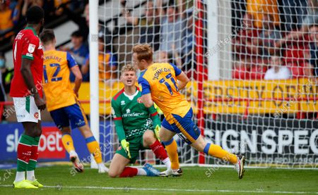 Danny Johnson of Mansfield Town scores past Carl Rushworth of Walsall