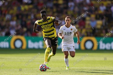 Ismaila Sarr of Watford runs with the ball
