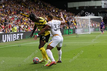 Ismaila Sarr of Watford holds off Adama Traore of Wolves