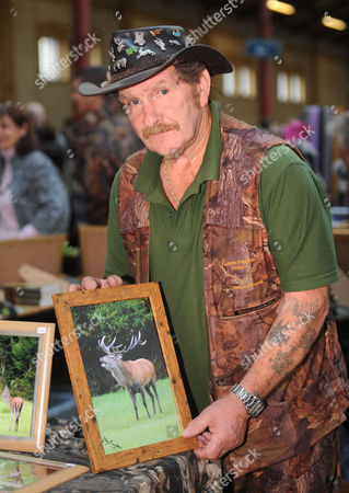Johnny Kingdom selling signed prints of the Emperor of Exmoor Stag