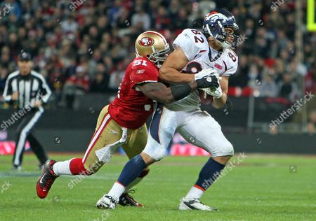 Dan Gronkowski of Denver Broncos is tackled by Takeo Spikes of San Francisco 49ers