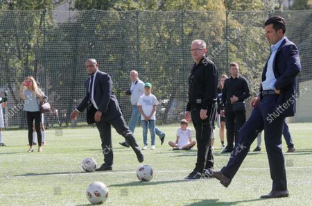 Stock Image of Luis Figo (R), the former Portuguese  professional footballer and Real Madrid player, with Roberto Carlos (L), former Brazilian professional footballer and ambassador of Real Madrid Foundation, during the kick off for a symbolic soccer game during the opening ceremony of the Real Madrid Foundation soccer school in the Kiev, Ukraine, 10 September 2021. Spanish LaLiga club Real Madrid CF develops its social and cultural  programmes with Real Madrid Foundation which unites more than 450 football schools in 80 countries. Real Madrid Foundation helps to promote the values inherent in sport, and its role as an educational tool both in Spain as well as abroad.