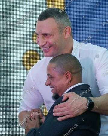 Kiev's Mayor and former heavyweight boxing champion Vitali Klitschko (up) reacts together with Roberto Carlos (down), former Brazilian professional footballer and ambassador of Real Madrid Foundation during the opening ceremony of the Real Madrid Foundation soccer school in the Kiev, Ukraine, 10 September 2021. Spanish LaLiga club Real Madrid CF develops its social and cultural  programmes with Real Madrid Foundation which unites more than 450 football schools in 80 countries. Real Madrid Foundation helps to promote the values inherent in sport, and its role as an educational tool both in Spain as well as abroad.