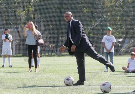 Stock Picture of Roberto Carlos,  former Brazilian professional footballer and ambassador of Real Madrid Foundation, gives a start for a symbolic soccer game during the opening ceremony of the Real Madrid Foundation soccer school in the Kiev, Ukraine, 10 September 2021. Spanish LaLiga club Real Madrid CF develops its social and cultural  programmes with Real Madrid Foundation which unites more than 450 football schools in 80 countries. Real Madrid Foundation helps to promote the values inherent in sport, and its role as an educational tool both in Spain as well as abroad.
