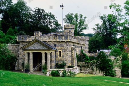 The Wormsley Estate, home of Victoria and J. Paul Getty, Jr. in England,  includes a crenellated stone library designed by architect Nicholas Johnston, constructed of local flint.