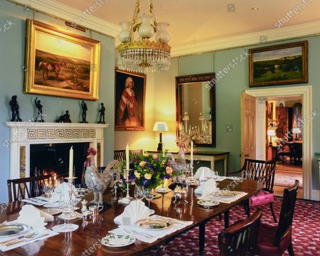 The Wormsley Estate, home of Victoria and J. Paul Getty, Jr. in England, includes a dining room with Joseph Durham bronze cricket players on the fireplace mantle with a Gainsborough portrait of Lord Westmoreland.