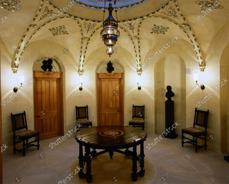 """The anteroom to library at Wormsley Estate, home of Victoria and J. Paul Getty, Jr. in England, includes stencils from Pugin's 1849 """"Floriated Ornament"""", a Syrian lantern, and busts of philosophers and poets."""