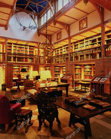 The medieval themed library at Wormsley Estate, home of Victoria and J. Paul Getty, Jr. in England, with Gothic arches, trefoil and quatrefoil motifs.