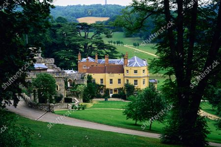Birds eye view of the southwest facade of Wormsley Estate, home of Victoria and J. Paul Getty, Jr. in England, including the medieval style, crenellated library and Georgian mansion.