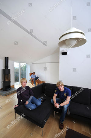 Stock Picture of Nigel Mitchell and his children Issey and Harry in the living areas of Prospect House, their Bath home.