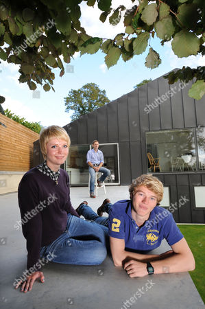 Nigel Mitchell and his children Issey and Harry in the newly landscaped garden of Prospect House, their Bath home.