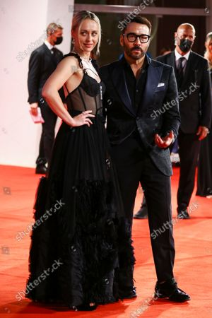 Laura Haddock, left, and Jeremy Piven pose for photographers upon arrival at the premiere of the film 'The Last Duel' during the 78th edition of the Venice Film Festival in Venice, Italy