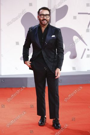 Jeremy Piven poses for photographers upon arrival at the premiere of the film 'The Last Duel' during the 78th edition of the Venice Film Festival in Venice, Italy