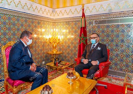 In this photo released by the Royal Palace, Morocco's King Mohammed VI, right, receives Aziz Akhannouch the president of the National Rally of Independents party (RNI), winner of the legislative elections at the Royal Palace in Fez, Morocco, . The monarch has charged the new head of state to constitute the new government