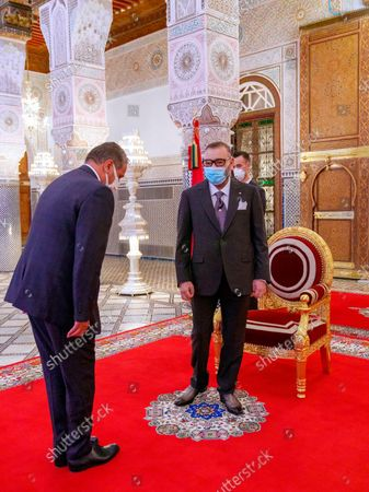 Stock Picture of In this photo released by the Royal Palace, Morocco's King Mohammed VI, right, receives Aziz Akhannouch the president of the National Rally of Independents party (RNI), winner of the legislative elections at the Royal Palace in Fez, Morocco, . The monarch has charged the new head of state to constitute the new government