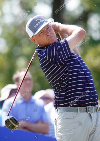 Stock Picture of Golfer  Davis Love III swings on his tee shot on hole one In The Ascension Charity Classic in St. Louis on Friday, September 10, 2021.