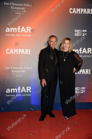 Carlo Capasa and Stefania Rocca pose on the red carpet at the amfAR gala in historical Arsenale in the frame of the 78th annual Venice International Film Festival, in Venice, Italy, 10 September 2021. The outdoor event is to benefit amfAR, The Foundation for AIDS Research. The 78th Venice Film Festival runs from 01 to 11 September 2021.