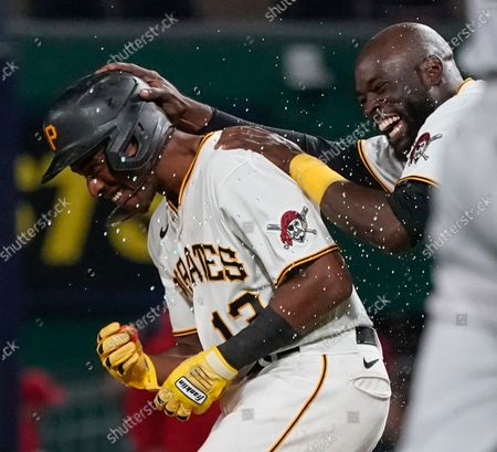 Pittsburgh Pirates' Ke'Bryan Hayes, left, celebrates with Anthony Alford after driving in Ben Gamel with the winning run in the ninth inning of a baseball game against the Washington Nationals, in Pittsburgh. The Pirates won 4-3