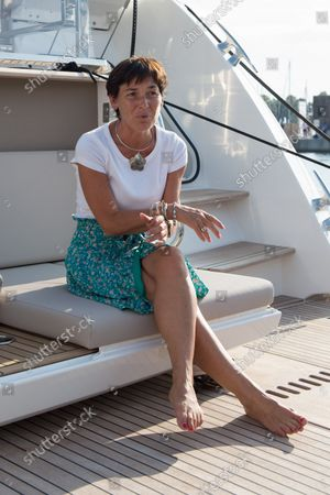 """Annick Girardin is seen sitting on a luxury yacht during the festival. Annick Girardin (minister of the sea) inaugurated and visited the Cannes Yachting Festival.  Canceled in 2020 because of the Coronavirus pandemic, it is the biggest """"boat show"""" in Europe. More than 560 new boats will be exhibited, of which nearly 150 will be world premieres. For the first time, a """"green"""" course is set up following the obligation voted by law to reserve 1% of the places in port for electric boats in French ports."""