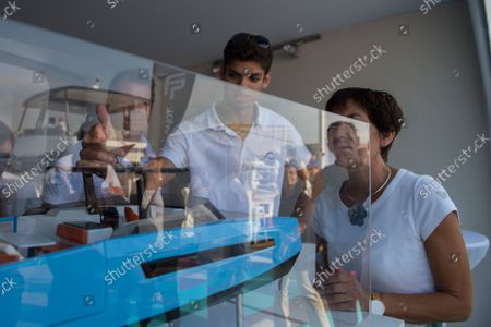 """Annick Girardin is seen in front of the new model of a French boatbuilder, during the festival. Annick Girardin (minister of the sea) inaugurated and visited the Cannes Yachting Festival.  Canceled in 2020 because of the Coronavirus pandemic, it is the biggest """"boat show"""" in Europe. More than 560 new boats will be exhibited, of which nearly 150 will be world premieres. For the first time, a """"green"""" course is set up following the obligation voted by law to reserve 1% of the places in port for electric boats in French ports."""
