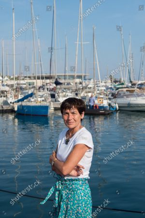 """Annick Girardin is seen on the port of Cannes with sailboats in the background, during the festival. Annick Girardin (minister of the sea) inaugurated and visited the Cannes Yachting Festival.  Canceled in 2020 because of the Coronavirus pandemic, it is the biggest """"boat show"""" in Europe. More than 560 new boats will be exhibited, of which nearly 150 will be world premieres. For the first time, a """"green"""" course is set up following the obligation voted by law to reserve 1% of the places in port for electric boats in French ports."""