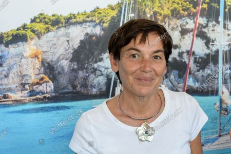 """Annick Girardin is seen in front of a calanque's wallpaper during her visit to the festival. Annick Girardin (minister of the sea) inaugurated and visited the Cannes Yachting Festival.  Canceled in 2020 because of the Coronavirus pandemic, it is the biggest """"boat show"""" in Europe. More than 560 new boats will be exhibited, of which nearly 150 will be world premieres. For the first time, a """"green"""" course is set up following the obligation voted by law to reserve 1% of the places in port for electric boats in French ports."""