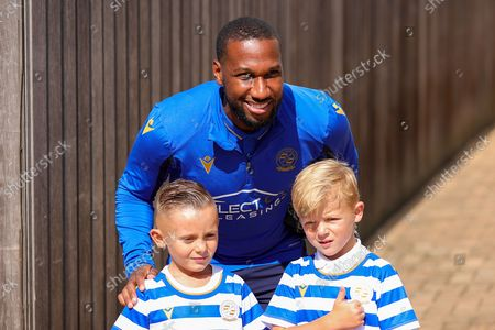 Junior Hoilett (23) of Reading arrives at the stadium and poses with young fans during the EFL Sky Bet Championship match between Reading and Queens Park Rangers at the Select Car Leasing Stadium, Reading