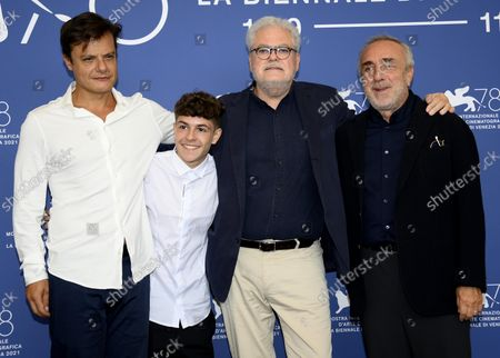 Italian actor Lino Musella, Italian actor Giuseppe Pirozzi, Italian filmmaker Roberto Ando' and Italian actor Silvio Orlando pose at a photocall for 'Il Bambino nascosto' during the 78th annual Venice International Film Festival, in Venice, Italy, 11 September 2021. The movie is presented out of competition at the festival that is running from 01 to 11 September.