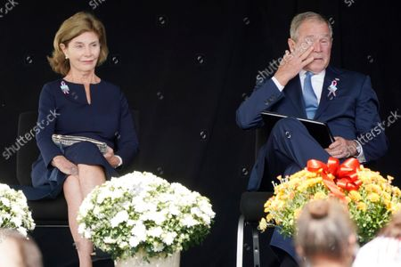 Former President George W. Bush, right, wipes his eyes next to former first lady Laura Bush, after he spoke at a memorial for the passengers and crew of United Flight 93, in Shanksville, Pa., on the 20th anniversary of the Sept. 11, 2001, attacks