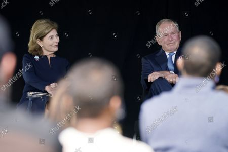 Former President George W. Bush, right, next to former first lady Laura Bush, takes his seat after he spoke at a memorial for the passengers and crew of United Flight 93, in Shanksville, Pa., on the 20th anniversary of the Sept. 11, 2001, attacks