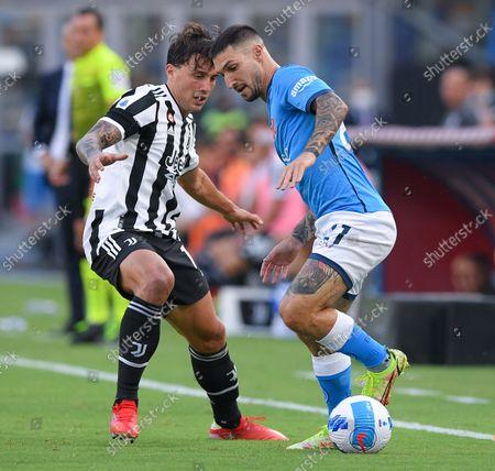Luca Pellegrini of FC Juventus and Matteo Politano of SSC Napoli compete for the ball during the Serie A match between SSC Napoli and FC Juventus at Stadio Diego Armando Maradona, Napoli, Italy on 11 September 2021.